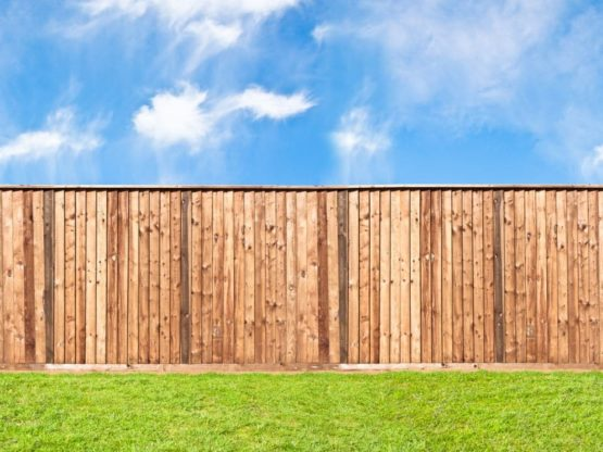 Timber Fence installed in a backyard on grass